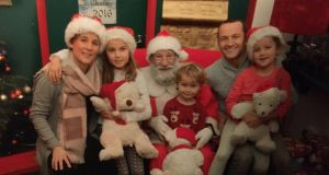 James Parnell with his family: Hoping to have the best of both worlds this Christmas.