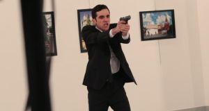 An unnamed gunman after shooting the Russian ambassador to Turkey, Andrei Karlov, at a gallery in Ankara, Turkey. Photograph: Burhan Ozbilici/AP Photo