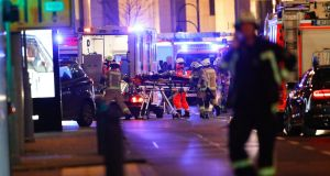 Paramedics work at the site of a crash at a Christmas market in  Berlin, Germany. Photograph: Fabrizio Bensch/Reuters