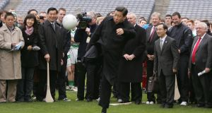 China's then vice president  Xi Jinping kicking a football on the pitch at Croke Park during a visit to Croke Park. Photograph: Alan Betson