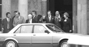 British prime minister Margaret Thatcher flanked by Geoffrey Howe and Tom King wave goodbye after the signing of the Anglo-Irish Agreement in Hillsborough, Co Down, in May 1985. Photograph: Pat Langan
