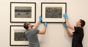 Art handlers prepare Aran 2005, a selection of black and white photographs which were part of an exhibition by artist Sean Scully at the National Gallery of Ireland in 2015. Photograph: Dara Mac Dónaill