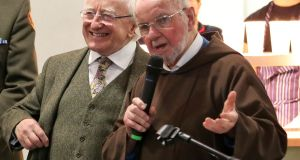 President Michael D Higgins with Br  Kevin Crowley during a visit to the Capuchin Day Centre in Dublin's Smithfield. Photograph: Colin Keegan/Collins