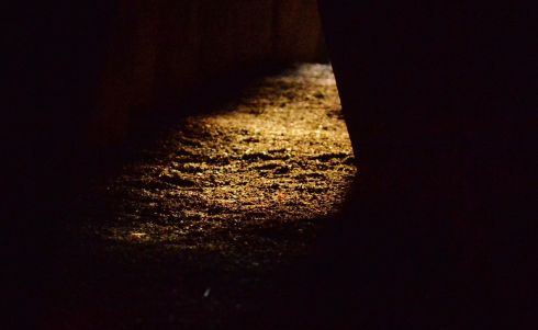 Golden sunshine appeared in the passage for a few brief moments during the Winter Solstice at Newgrange. Overcast conditions relented briefly at approx 9:25am to let sunshine in to the passageway.   Photograph: Alan Betson / The Irish Times