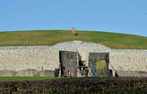 A naked visitor on top of  Newgrange mid morning after the Winter Solstice at Newgrange.  Photograph: Alan Betson / The Irish Times