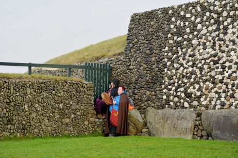 Visitors at Newgrange as  the clouds parted briefly to let sunshine appear  in the passage for a few moments during the Winter Solstice at Newgrange.  Photograph: Alan Betson / The Irish Times
