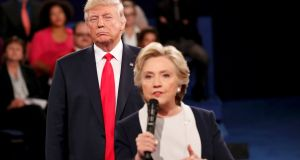 Look out, he's behind you: Republican US presidential nominee Donald Trump listens as Democratic nominee Hillary Clinton answers a question from the audience during their presidential town hall debate at Washington University in St Louis, Missouri in October, photograph by Rick Wilking/Reuters
