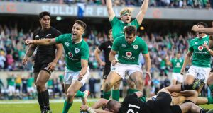 The all-conquering heroes of Soldier Field, Chicago, as Ireland defeated New Zealand in November by 40 points to 29. It was Ireland's first win against the All Blacks in 111 years. Here, Conor Murray celebrates Robbie Henshaw's try, photograph by Billy Stickland/Inpho