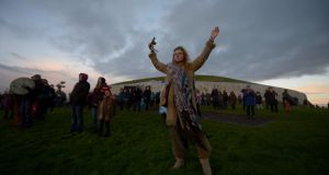 Revellers celebrate during the winter solstice at  Newgrange, Co Meath. Photograph: Clodagh Kilcoyne/Reuters