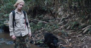 Brian Crudge, from Cobh in Co Cork, walks a bear at the rescue centre where he works in Cambodia. Bears in the region are vulnerable to poaching for their bile, which is prized in Chinese medicine.