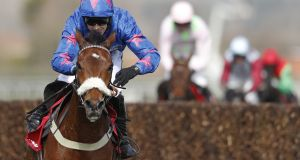 "Paddy Brennan riding Cue Card to win at Aintree in April. ""I couldn't be happier with him,"" says the jockey. Photograph:  Alan Crowhurst/Getty Images."