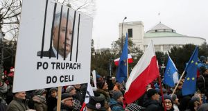 "Demonstrators in front of the parliament building in Warsaw on Tuesday. The poster roughly translates as ""Over the corps to the cell"". Photograph: Agencja Gazeta/Kuba Atys/via Reuters"