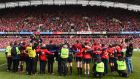 Munster players and staff sing 'Stand Up and Fight' on the pitch after beating Glasgow Warriors at Thomond Park. Photograph: Diarmuid Greene/Sportsfile via Getty Images
