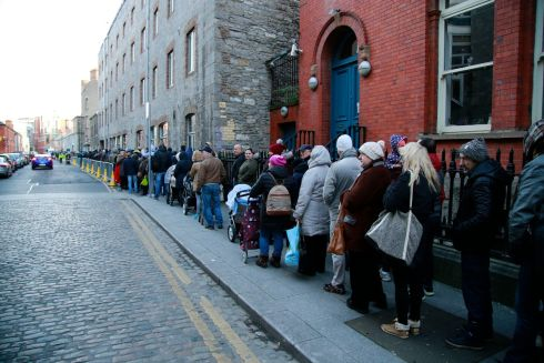 People queuing for Christmas food parcels at the Capuchin Centre in Dublin. Photograph:  Nick Bradshaw