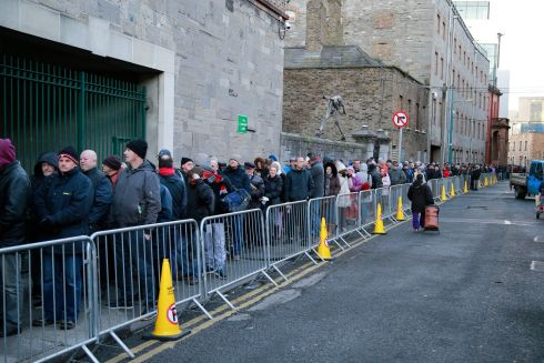 About 2,500 people, including elderly people and children, queued for Christmas food parcels at the Capuchin Centre in Dublin on Thursday. Photograph: Nick Bradshaw