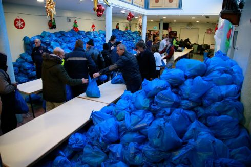 Sorting Christmas food parcels at the Capuchin Centre in Dublin. Photograph: Nick Bradshaw