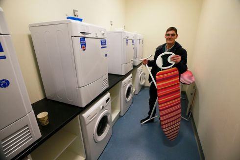 """Roy"" in the laundry room at the Peter McVerry Trust hostel at Ellis Quay, Dublin. Photograph: Nick Bradshaw"