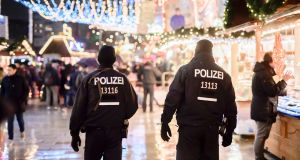Police patrol at the reopened Christmas market  in Berlin after a deadly truck attack. Photograph: Clemens Bilan/AFP/Getty Images