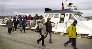 An Island Ferries boat carries passengers from Inis Mór. Photograph: David Sleator