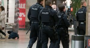 A unit of police officers is seen during a security operation in the shopping centre Centro in Oberhausen on Thursday. Photograph:Arnulf Stoffel