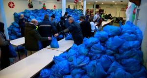 Sorting Christmas food parcels at the Capuchin Centre in Dublin on Thursday. Photograph: Nick Bradshaw