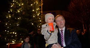 Taoiseach Enda Kenny with Evan O'Brien after he turned on the Buckingham Street Christmas tree lights recently. Photograph: Eric Luke