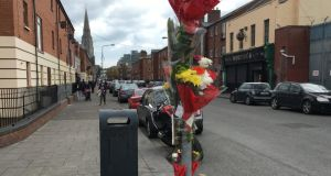 Flowers at the site of the murder of Martin O'Rourke, who was shot dead in April in a gangland attack on Sheriff Street, Dublin. Photograph: Peter Murtagh