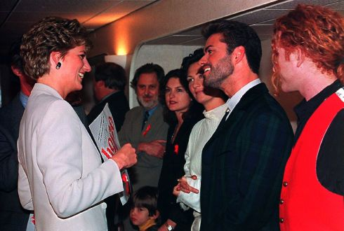 Britain's Princess Diana, Patron of the National AIDS Trust chats with singer George Michael before the start of the Concert of Hope at Wembley Arena in London to mark World AIDS Day December 1, 1993. To the immediate left of George Michael is singer K.D.Lang of Canada, and to the right Mick Hucknall of Simply Red. Photograph: Pool/Reuters