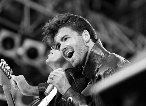 George Michael on stage for Wham's last sell out concert at Wembley Stadium in London in 1986. Photograph: PA/PA Wire.