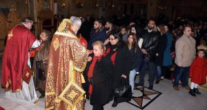 Christians attend prayers during christmas mass at the elias orthodox