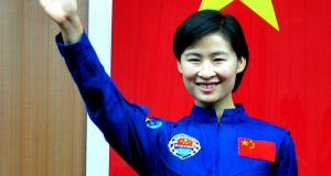 China's first female astronaut Liu Yang. A slowdown in the economic  growth rate, combined with a return to traditional Confucian family values, has worked against women.  Photograph: STR/AFP/GettyImages