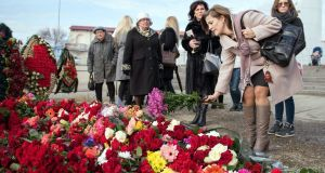 People lay flowers at a Sochi embankment the day after a Russian military plane crashed in the Black Sea, with no sign of survivors among the 92 onboard.  Photograph: Ekaterina Lyzlova/AFP/Getty Images