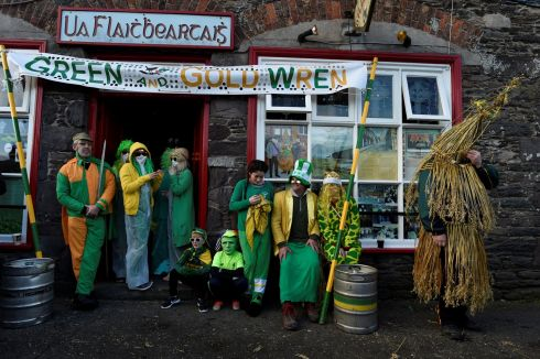 Costumed participants also known as 'mummers' or 'strawboys', celebrate the wren by dressing up in masks, straw suits, and colourful clothing. Photograph: Clodagh Kilcoyne/Reuters