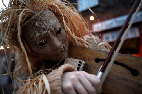 Traditionally, the wrenboys would sing a song or play some music and would be given money in return for their efforts. Photograph: Clodagh Kilcoyne/Reuters