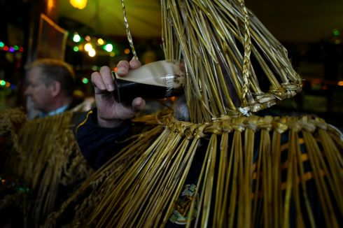 A costumed participant drinks a pint of Guinness. Photograph: Clodagh Kilcoyne/Reuters