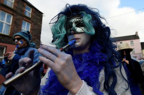 A costumed participant plays the tin whistle during an Irish tradition of Hunting of the Wren festival held every St Stephen's Day in Dingle. Photograph: Clodagh Kilcoyne/Reuters