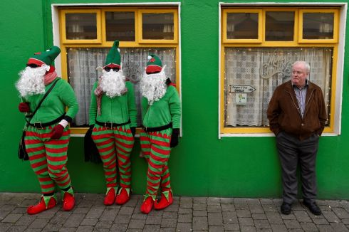 Costumed people are seen during the Wren Day  festival held every St Stephen's Day. Photograph: Clodagh Kilcoyne/Reuters
