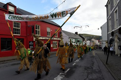 Mummers lead the parade in Dingle. Photograph: Clodagh Kilcoyne/Reuters