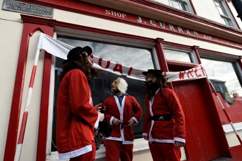 Costumed participants in Santa Claus outfits prepare for the parade. Photograph: Clodagh Kilcoyne/Reuters