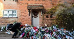 A woman lays flowers outside the Oxfordshire home of singer George Michael, who was found dead at home on Christmas Day. Photograph: Jack Taylor/Getty