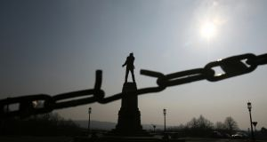 The statue of Sir Edward Carson, a leader of the Irish unionists, seen through a broken link at the Stormont Assembly building in Belfast. Photograph: Adrian Dennis/AFP/Getty