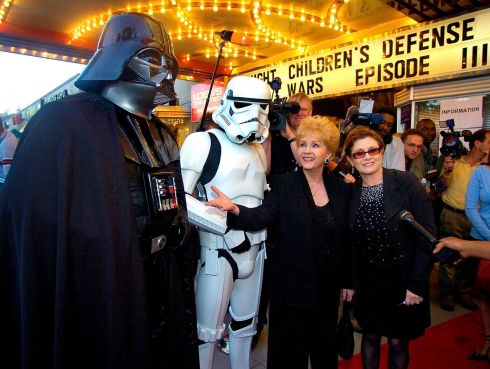 "May 2005:  US actress Debbie Reynolds  and daughter Carrie Fisher, who played Princess Leia in the original Star Wars movie, joining a Darth Vader  and a Stormtrooper character as they arrive for the premiere of ""Star Wars Episode III: Revenge of the Sith"" in Washington DC."