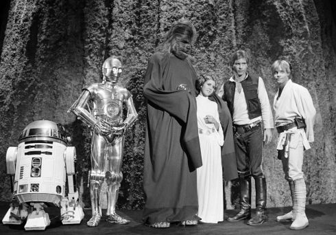 "November 1978: From left, Kenny Baker, Anthony Daniels, Peter Mayhew, Carrie Fisher, Harrison Ford, and Mark Hamill during the filming of the CBS-TV special ""The Star Wars Holiday"" in Los Angeles.  Photograph: George Brich"