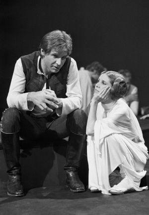 "November 1978: Harrison Ford talks with Carrie Fisher during a break in the filming of the CBS-TV special ""The Star Wars Holiday"" in Los Angeles.  Photograph: George Brich"