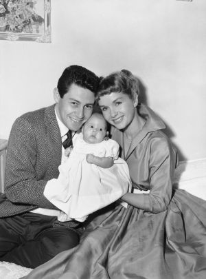 January 1957: Eddie Fisher and Debbie Reynolds hold their baby daughter, Carrie Frances Fisher. Photograph; AP