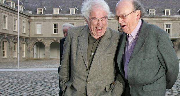 Poets Seamus Heaney and Anthony Cronin enjoy a light moment. Photograph: Brenda Fitzsimons