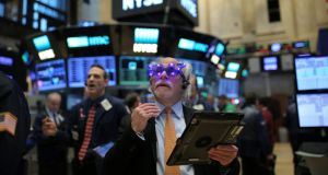 Wall Street was flat after the open on the last trading day of 2016 due to losses across most sectors, but was still on track to record hefty gains for the year.  Photograph: Stephen Yang/Reuters
