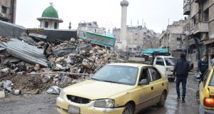 Rubble is seen in the  al-Kallasseh area in the eastern neighborhoods of Aleppo on Friday. Photograph: EPA