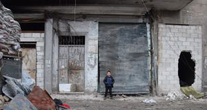 A child in one of the alleys of the al-Kallasseh area in the eastern neighborhoods of Aleppo, on Friday  captured by rebel forces in 2012, was lately cleared in accordance with an agreement with the Syrian government that gave them a safe exit to the southern part of Aleppo or to Idlib province. Photograph: EPA