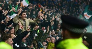 Celtic fans celebrate their team's first goal during the Ladbrokes Scottish Premiership match between Rangers and Celtic at Ibrox Stadium. Photo: Mark Runnacles/Getty Images
